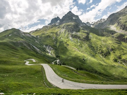 Cyclist on French Alps backroad